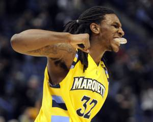 ORG XMIT: CTFB105 Marquette's Jae Crowder celebrates after his team's 74-67 overtime victory against Connecticut in an NCAA college basketball game in...