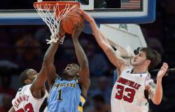 Louisville Cardinals' Jennings and Marra block a shot by Marquette Golden Eagles' Johnson-Odom during the second half of their NCAA men's basketball game...