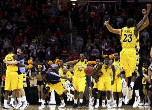 Marquette University's team runs onto court after defeating Syracuse University...