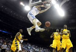 North Carolina Tyler Zeller dunks the ball during the first half of their NCAA East Regional game against Marquette Friday, March 25, 2011 at the Prudential Center in Newark, N.J.  Marquette lost to North Carolina 81-63.  MARK...