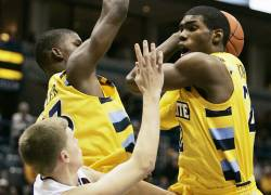 mumen19p13, mjs, news - Marquette's Jamail Jones tries to get a shot up in the second half, in Milwaukee on Tuesday, December 14, 2010. PHOTO BY MARK...