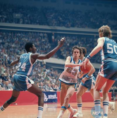 28 MAR 1977:  Marquette guard Jim Boylan (23) and North Carolina forward Walter Davis (24) and center Rich Yonakor (50) during the NCAA Men's National Basketball Final Four championship game held in Atlanta, GA, at The Omni. Marquette defeated North Carolina 67-59 for the title. Photo by Rich...