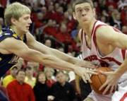 Wisconsin's Jon Leuer is fouled by Marquette's Scott Christopherson in the 2nd half. The University of Wisconsin Men's basketball team hosted Marquette University at the Kohl Center Saturday December 8, 2007. Steve Apps-State...