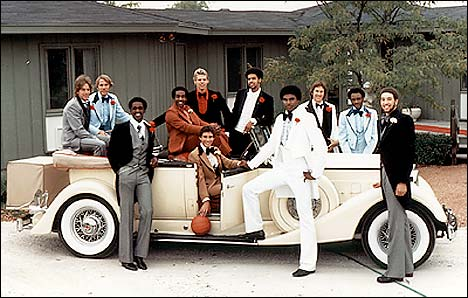 1977 Championship team posed around a 1934 Packard Convertible